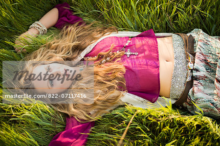 Woman Lying in Long Grass Stock Photo - Rights-Managed, Image code: 822-07117416