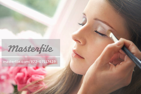Teenage Girl Having Eyeshadow Applied Stock Photo - Rights-Managed, Image code: 822-07117439