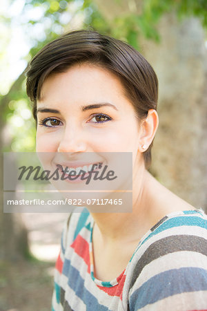 Smiling Young Woman Outdoors Stock Photo - Rights-Managed, Image code: 822-07117465