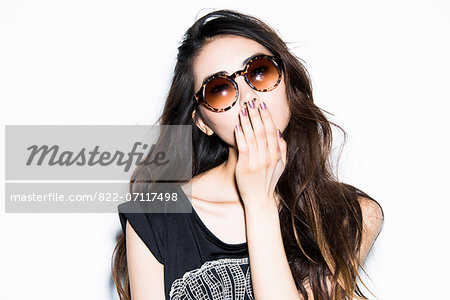 Young Woman Blowing Kiss Stock Photo - Rights-Managed, Image code: 822-07117498