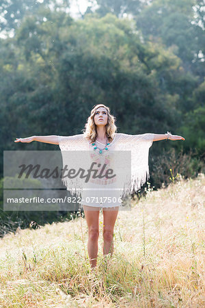 Young Woman in Meadow with Arms Extended Stock Photo - Rights-Managed, Image code: 822-07117506
