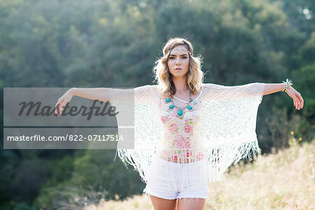 Young Woman in Meadow with Arms Extended Stock Photo - Rights-Managed, Image code: 822-07117514