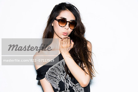 Young Woman Blowing Kiss Stock Photo - Rights-Managed, Image code: 822-07117519