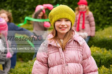 Smiling Young Girl Outdoors Stock Photo - Rights-Managed, Image code: 822-07117557
