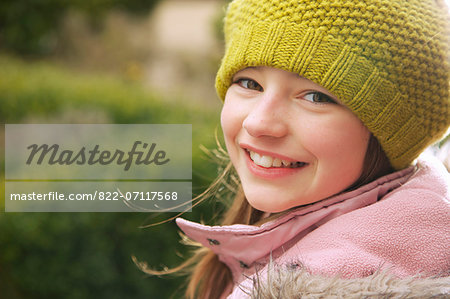 Smiling Young Girl Outdoors Stock Photo - Rights-Managed, Image code: 822-07117568