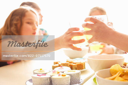 Girls Toasting Around Table, Close-up View Stock Photo - Rights-Managed, Image code: 822-07117570