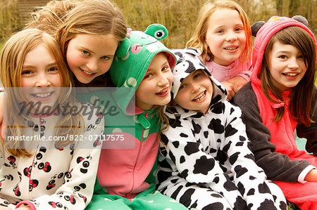 Group of Smiling Girls Wearing Animal Costumes Stock Photo - Rights-Managed, Image code: 822-07117575