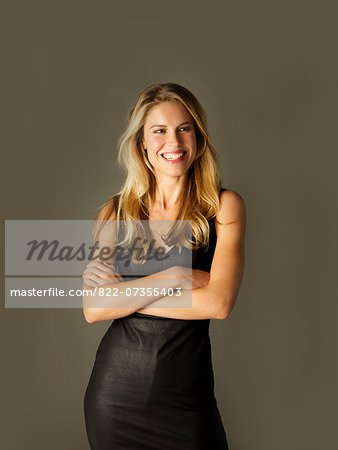Attractive Blonde Woman with Arms Crossed Smiling Stock Photo - Rights-Managed, Image code: 822-07355403