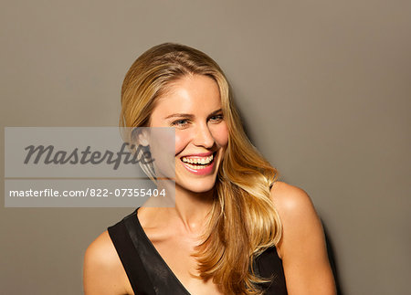 Attractive Blonde Woman Smiling Stock Photo - Rights-Managed, Image code: 822-07355404