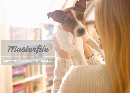 Back View of Woman Holding Dog Stock Photo - Rights-Managed, Image code: 822-07355455