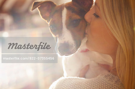 Young Woman Kissing Dog Stock Photo - Rights-Managed, Image code: 822-07355456