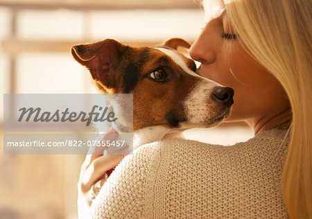Young Woman Kissing Dog Stock Photo - Rights-Managed, Image code: 822-07355457