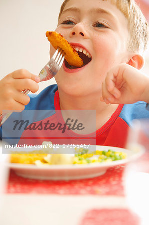 Young Boy Eating Fish fingers and Vegetables Stock Photo - Rights-Managed, Image code: 822-07355467