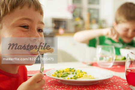 Young Boy Eating Fish fingers and Vegetables Stock Photo - Rights-Managed, Image code: 822-07355471