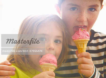 Boy and Girl Eating Ice Cream Stock Photo - Rights-Managed, Image code: 822-07355474