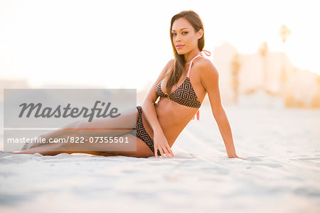 Woman on Beach Sitting on Sand Stock Photo - Rights-Managed, Image code: 822-07355501