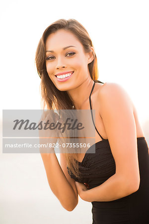 Attractive Woman Smiling Outdoors Stock Photo - Rights-Managed, Image code: 822-07355506