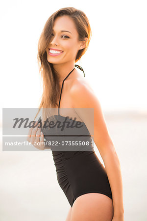 Attractive Woman Smiling on Beach Stock Photo - Rights-Managed, Image code: 822-07355508