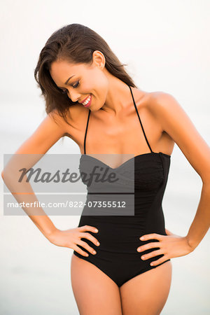 Woman Wearing Black Swimsuit with Hands on Hips Stock Photo - Rights-Managed, Image code: 822-07355512