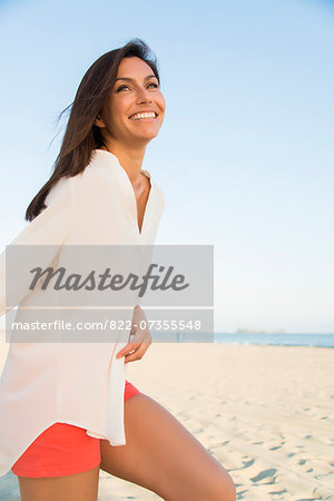 Smiling Woman on Beach Stock Photo - Rights-Managed, Image code: 822-07355548