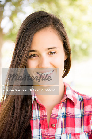Portrait of Young Woman Smiling Stock Photo - Rights-Managed, Image code: 822-07355564