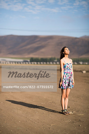 Woman Standing on Dry Field Stock Photo - Rights-Managed, Image code: 822-07355572