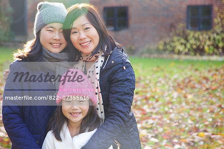 Mother and her Daughters Smiling Outdoors Stock Photo - Rights-Managed, Image code: 822-07355616
