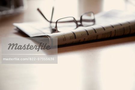 Eyeglasses on Newspaper Stock Photo - Rights-Managed, Image code: 822-07355636