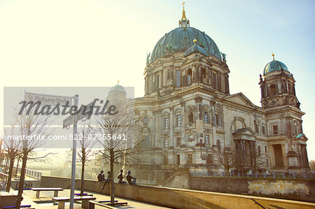 """Drei Mädchen und ein Knabe"" (Three Girls and a Boy) by Wilfried Fitzenreiter, 1988, Berlin Cathedral in background Stock Photo - Rights-Managed, Image code: 822-07355641"