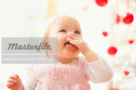 Portrait of Baby Girl with Finger in Mouth and Tongue Sticking Out Stock Photo - Rights-Managed, Image code: 822-07355651