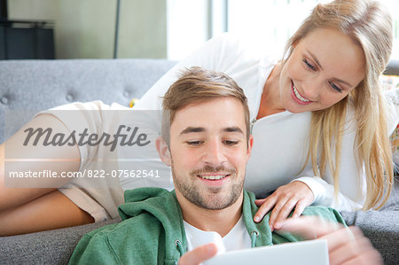 Couple on Sofa Using Smartphone Stock Photo - Rights-Managed, Image code: 822-07562541