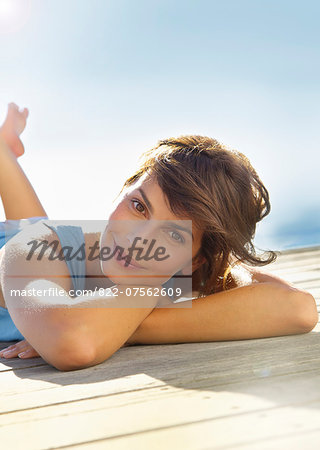 Smiling Woman Lying Outdoors Stock Photo - Rights-Managed, Image code: 822-07562609