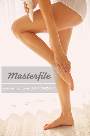 Woman Applying Body Lotion on Foot, Low Section Stock Photo - Rights-Managed, Image code: 822-07562623