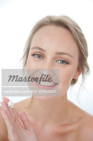 Smiling Woman with Moisturizing Cream on Nose Stock Photo - Rights-Managed, Image code: 822-07562657