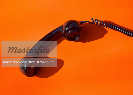 Telephone Handset on Orange Background Stock Photo - Rights-Managed, Image code: 822-07562683