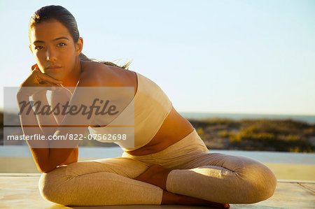 Young Woman Sitting with Legs Crossed Leaning to one side Stock Photo - Rights-Managed, Image code: 822-07562698