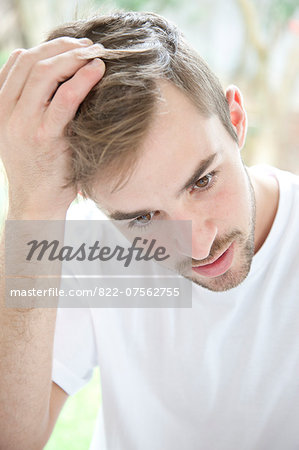 Portrait of Concerned Man Stock Photo - Rights-Managed, Image code: 822-07562755