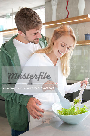 Young Couple Preparing Salad Stock Photo - Rights-Managed, Image code: 822-07562763
