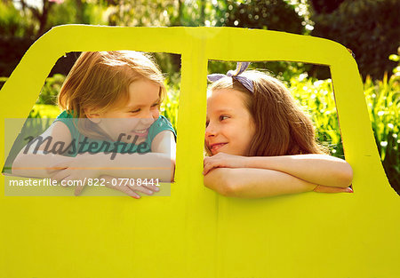 Young Girls Leaning out of Cardboard Car Window Stock Photo - Rights-Managed, Image code: 822-07708441