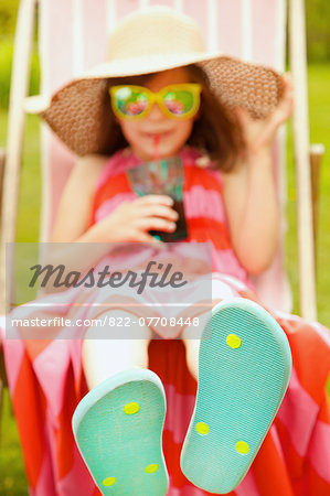 Girl on Deck Chair Wearing Flip Flops Stock Photo - Rights-Managed, Image code: 822-07708448