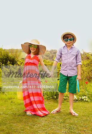 Boy and Girl Wearing Straw Hat and Sunglasses Smiling Stock Photo - Rights-Managed, Image code: 822-07708450