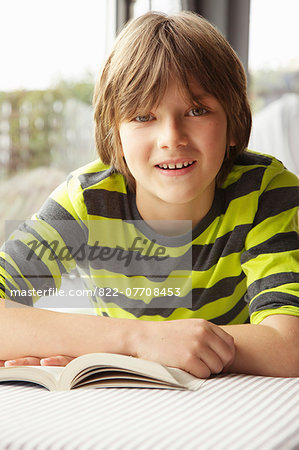 Boy Reading Book Stock Photo - Rights-Managed, Image code: 822-07708453