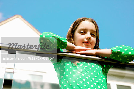 Young Girl Leaning on Balcony Railing Stock Photo - Rights-Managed, Image code: 822-07708457