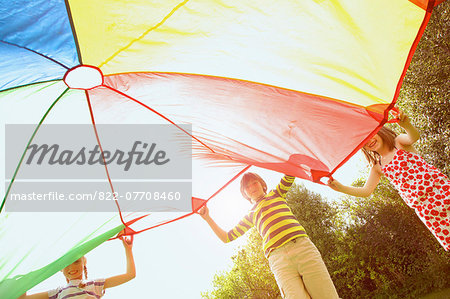 Children Playing under Parachute Stock Photo - Rights-Managed, Image code: 822-07708460