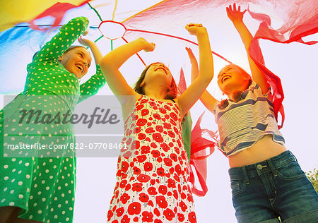 Children Playing under Parachute Stock Photo - Rights-Managed, Image code: 822-07708461