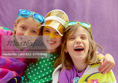 Young Girls Wearing Visor and Sunglasses Smiling Stock Photo - Rights-Managed, Image code: 822-07708465