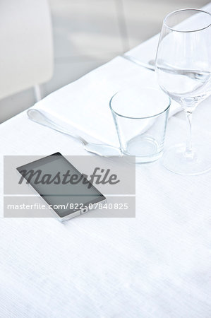 Place Setting with Smartphone Stock Photo - Rights-Managed, Image code: 822-07840825