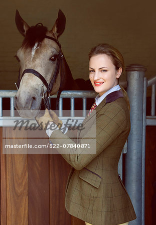 Woman with Horse Standing in front of Stable Stock Photo - Rights-Managed, Image code: 822-07840871