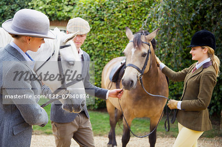 Man and Two Young Women with Two Horses Stock Photo - Rights-Managed, Image code: 822-07840874