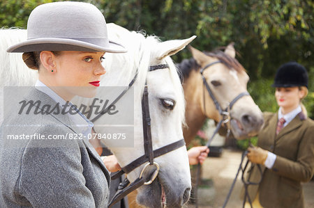 Profile of Young Woman with Horse Stock Photo - Rights-Managed, Image code: 822-07840875